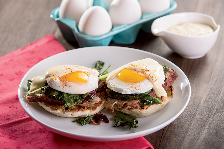 ... sauce , drizzled over Eggs Benedict with Wilted Spring Greens