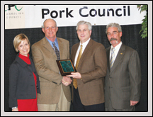 From left, Vicky Porter and Tommy Porter accept the North Carolina Pork Council's 2009 'Outstanding Pork Producers' Award from Carolina Farm Credit CEO Mike Morton and North Carolina Pork Council President George Pettus.