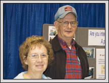 SAMPSON County Farm Bureau board member Buck Blanchard and his wife, Women's Committee member Shelby, visit NCFB's display at the Murphy-Brown Vendor Expo March 17 at<br /> the Duplin Events Center in Kenansville.