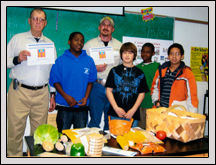 Wake County Farm Bureau members Richard Jenks, left, and Jay Thompson visit with students at Leesville Road Middle School on Career Day.