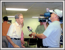 Davidson County Farm Bureau Member Henry Sink is interviewed by a television station after a surprise presentation of eight World War II medals.