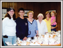 Yadkin County Farm Bureau's Women's Committee Members (from left) Heather Smith, Becky Smith, Karen Matthews, Martha Fleming and Cindy Matthews presented loaves of bread to teachers at Forbush and Starmount High Schools.