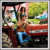Clay County Farm Bureau Member Glen Cheeks and his family were among the 80 entrants in the Tractor Parade.
