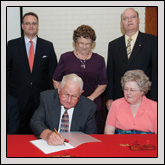 Rockingham County Farm Bureau has established a $50,000 scholarship to honor J.M. Wright Jr. On hand for the signing were (seated, left to right) Rockingham County Farm Bureau President Darryl Dunagan; J.M. Wright Jr.; Leola Meador, Scholarship Chair; (standing, left to right) Sharon Runion Rowland, Executive Director of the N.C. Cooperative Extension Foundation; Ken Sigmon, Associate Vice Chancellor at NCSU; Mrs. J.M. Wright; and Jon Ort, Assistant Vice Chancellor and Director of N.C. Cooperative Extension.