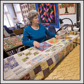 "Vance County Farm Bureau Member Debbie ""Miss Lou"" Powell demonstrates the quilting process."