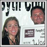From left, Stephanie Miller and Forsyth County Farm Bureau member Wade Jurney receive a $5,000 donation presented by Forsyth County Farm Bureau President Edgar Miller.