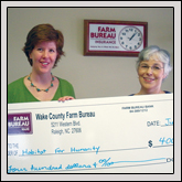 WAKE COUNTY Farm Bureau recently donated $400 for a miter saw to Habitat for Humanity on June 30. Nancy Jones of Habitat for Humanity, left, accepts the check from Board Member Shirley Burt.