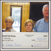 Farm Bureau gave each of the county's 11 schools $200 for school supplies. Pictured, left to right, are Women's Committee members Eloise Harrington, Nadine Phifer and Rita Mills and County President Ronnie Mills