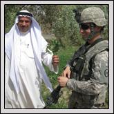 Burt discusses growing alfalfa with an Iraqi sheik.